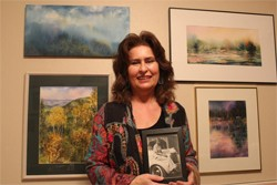 Sandra Yorke holding a photo of her mother